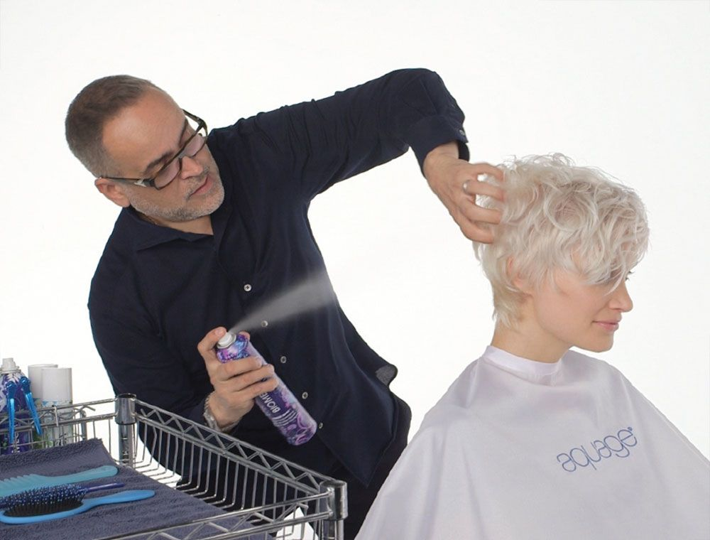 Alvarez demonstrates the disconnected lines technique that is trending this season, and uses Biomega Freeze Baby as a texturizer to hold on contact and style the look.
