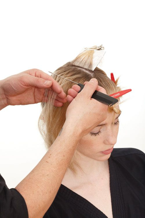 2. Beginning at the top of the section, take fine weaves from ¼-inch partings and place on foil. Sections will pivot from horizontal to diagonal as you move down the head.