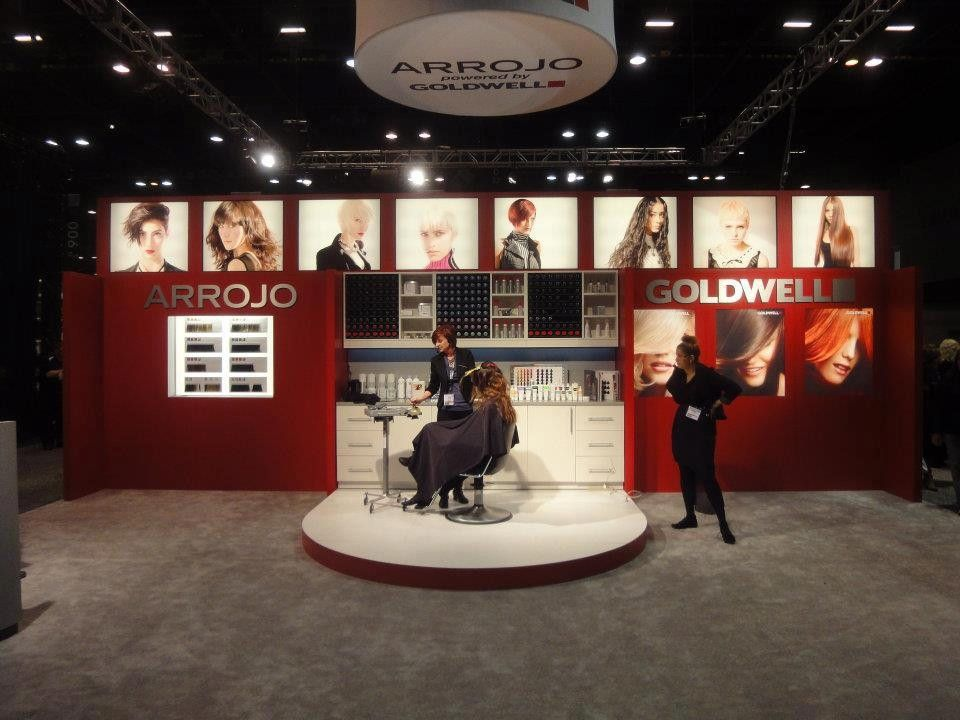 Julia Vittoro, owner of Fresh Salon in Charlotte, North Carolina, on stage educating for Arrojo.