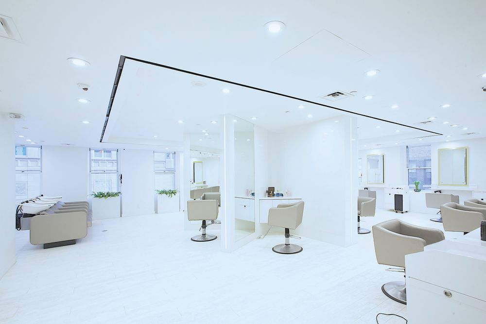"The nearly all-white décor of <a href=""http://arsengurgov.com/"" target=""_blank"" rel=""noopener"">The Arsen Gurgov Salon</a> in New York, New York, defines elegance. With its simplicity, it exudes extravagance, and the 14 large windows allow an abundance of natural light in order to make clients feel as though they've entered a salon in the clouds."