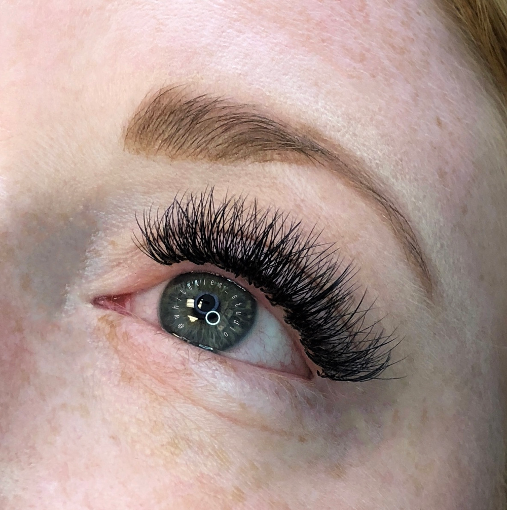 """<p><strong>Bam! This natural redhead's blonde lashes are transformed with NovaLash D-Curl, .10 volume lashes. """"We created a deep, dark lash line that gave her the confidence she needed for date night,"""" says NovaLash Ambassador Alison Colletti.</strong></p>"""