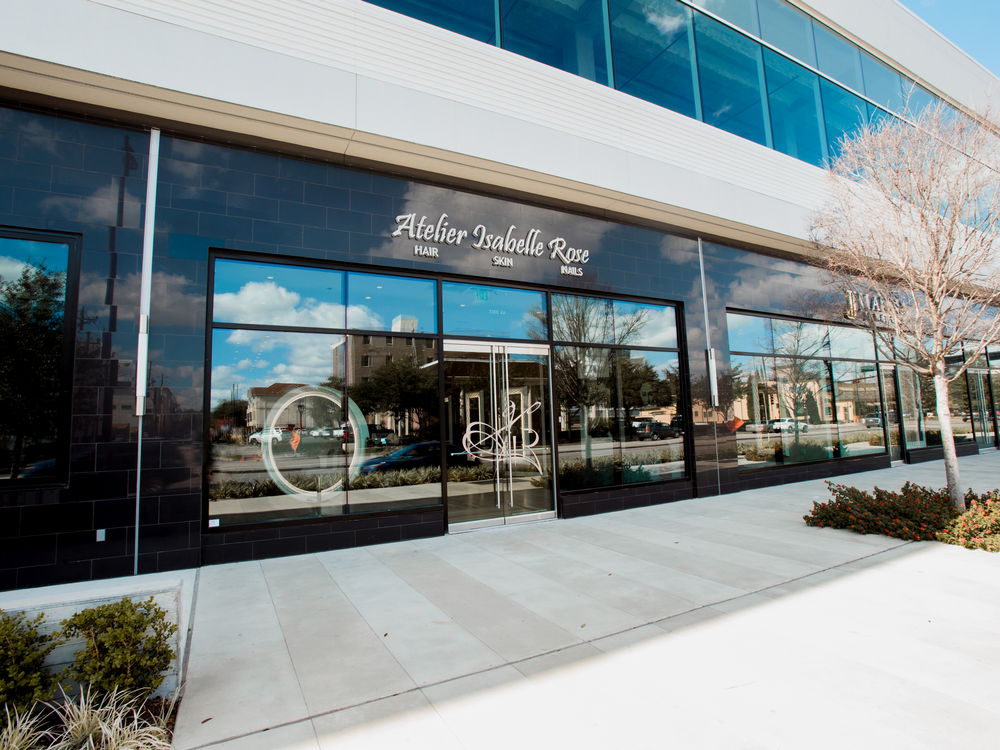 The modern storefront of Atelier Isabelle Rose in Houston, Texas, sets the stage for the chic and elegant decor inside.