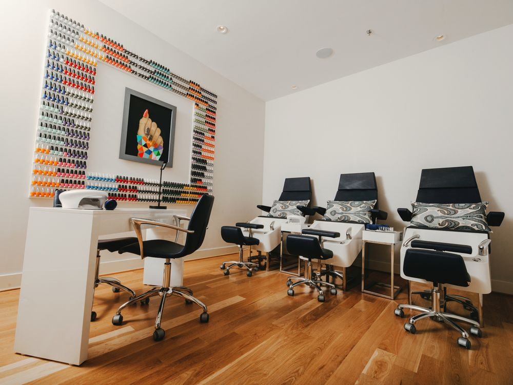 <p>A mural of nail lacquers bring color to the nail room at Atelier Isabelle Rose in Houston, Texas.</p>
