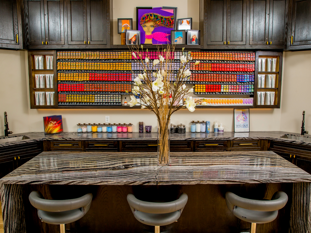 A wall of haircolor boxes bring and interesting punch of color to the color bar at Atelier Isabelle Rose in Houston, Texas.