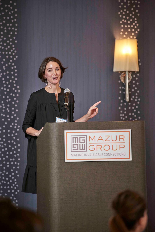 "(left) Elizabeth Maul (EVP of Brand Development, Luxury Brand Partners) at her Keynote Address ""Inspiring for Innovation"""