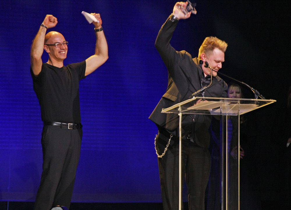 Cosmetologists Chicago President Joseph Cartagena celebrates with Chrystofer Benson who won three Start Photo categories and the Leo Passage Gold Trophy Award.