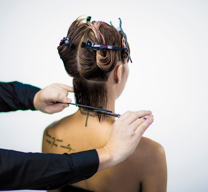 CUTTING TECHNIQUE: <p>STEP 2 - Release the back contour lines in small section and cut sharp from right to left. (Comb the hair at the nape area in small horizontal sections. Comb the hair in natural fall distribution and cut the hair in a horizontal line with comb control). Use the first section as your guide line. Last section, cut with finger control from right to left sharp and straight. (Cut the last section with finger control in a horizontal line).</p> <p> </p>