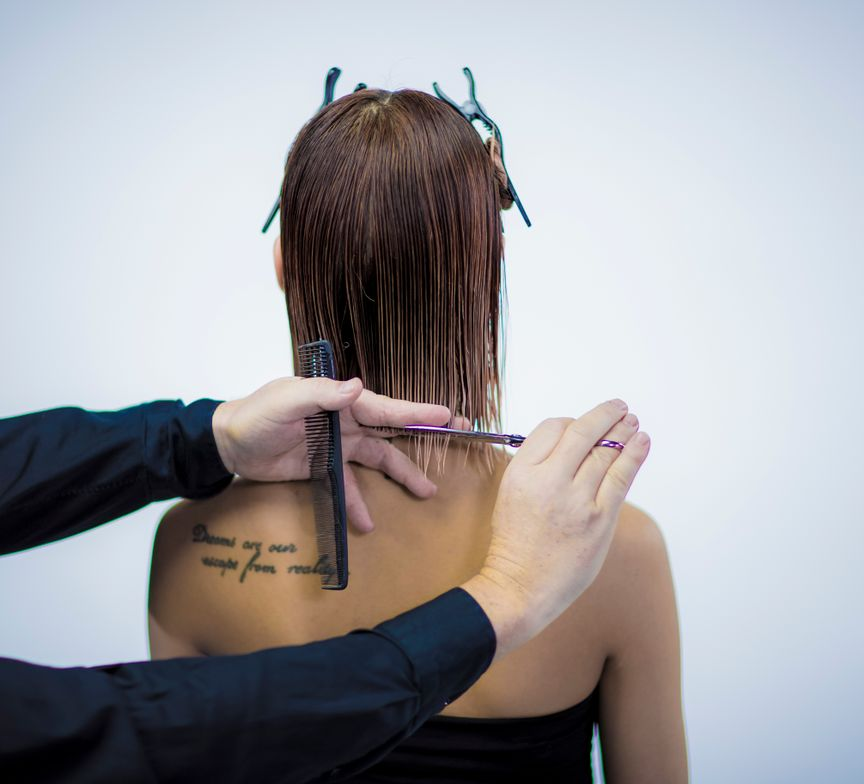 CUTTING TECHNIQUE: <p>Release the back contour lines in small section and cut sharp from right to left. (Comb the hair at the nape area in small horizontal sections. Comb the hair in natural fall distribution and cut the hair in a horizontal line with comb control). Use the first section as your guide line. Last section, cut with finger control from right to left sharp and straight. (Cut the last section with finger control in a horizontal line).</p> <p> </p> <p> </p>