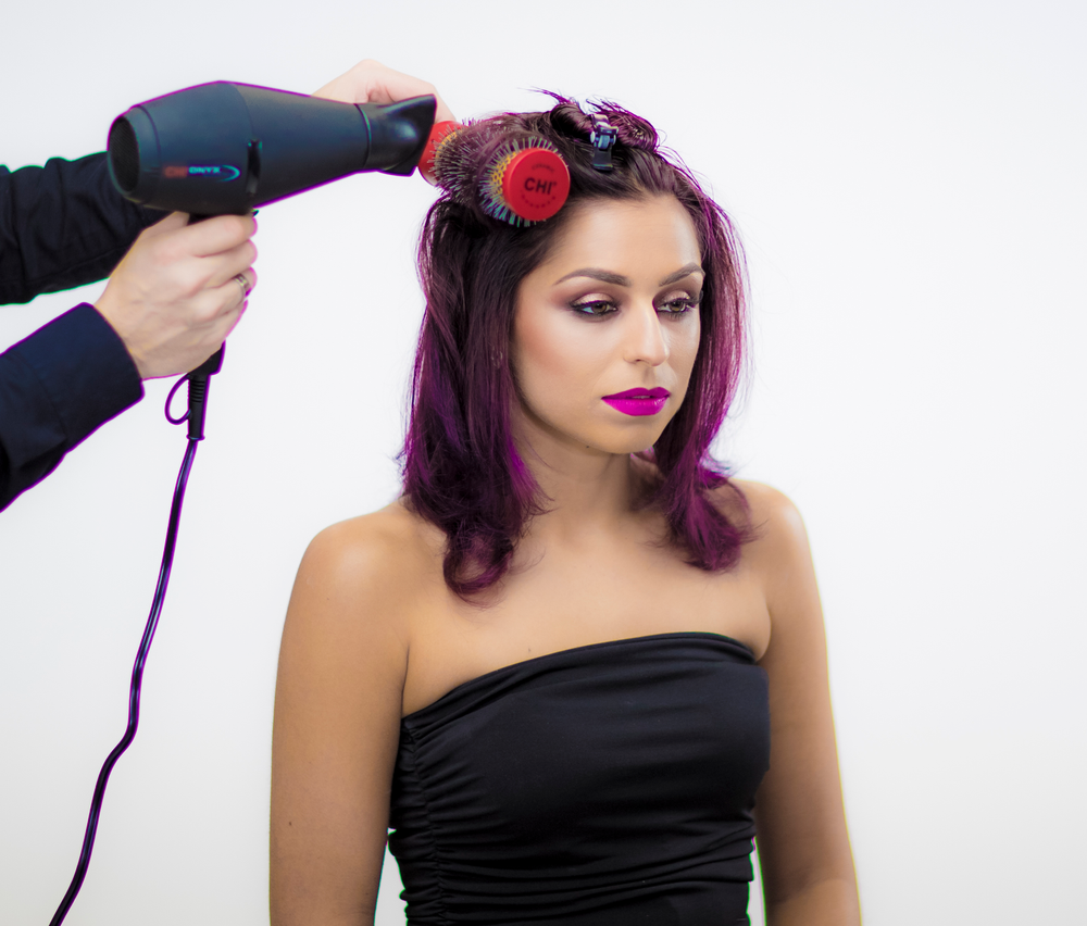 <strong>STYLING: STEP 2</strong> - Blow dry the hair with the CHI Onyx Euro Shine Blow dryer and the medium CHI Ceramic round brush. Create Volume on the roots and polish the ends with the Ion generator.