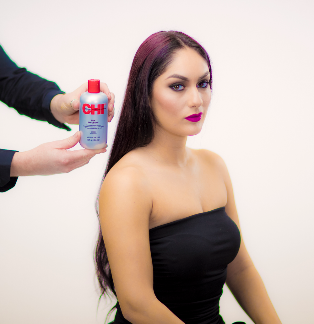 STYLING: <strong>STEP 1</strong> - Apply a rich amount of CHI Silk Infusion through the hair for shine and protection.