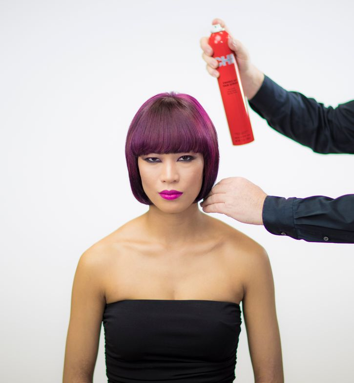 <strong>STEP 1</strong> - After blow-drying, spray CHI Shine Infusion on the hair.