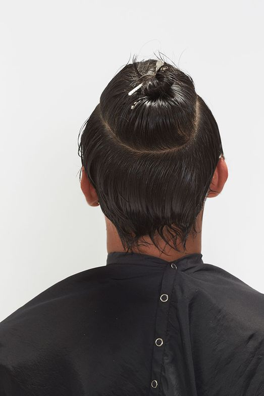 1. Section hair as shown, isolating all the hair above the rounds of the head.