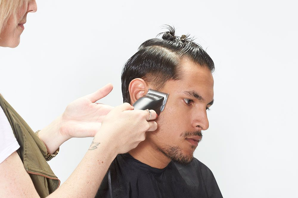 2. Begin the cut on the side at the side burn. Cut straight across using the Excel Ultra Clipper, a detachable blade clipper.