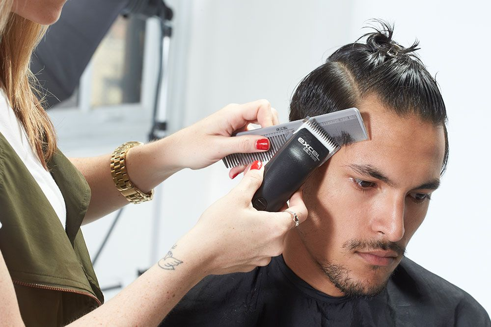 4. Direct the temple strands forward using clipper over comb.