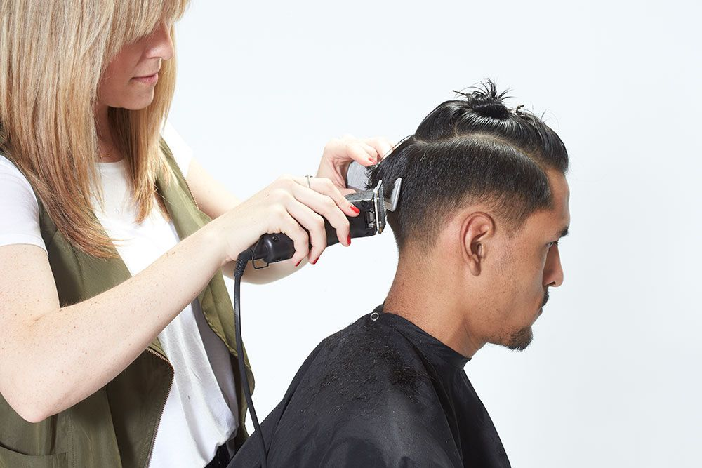 5. Clean up the line behind the ear to the nape and blend up to the occipital.