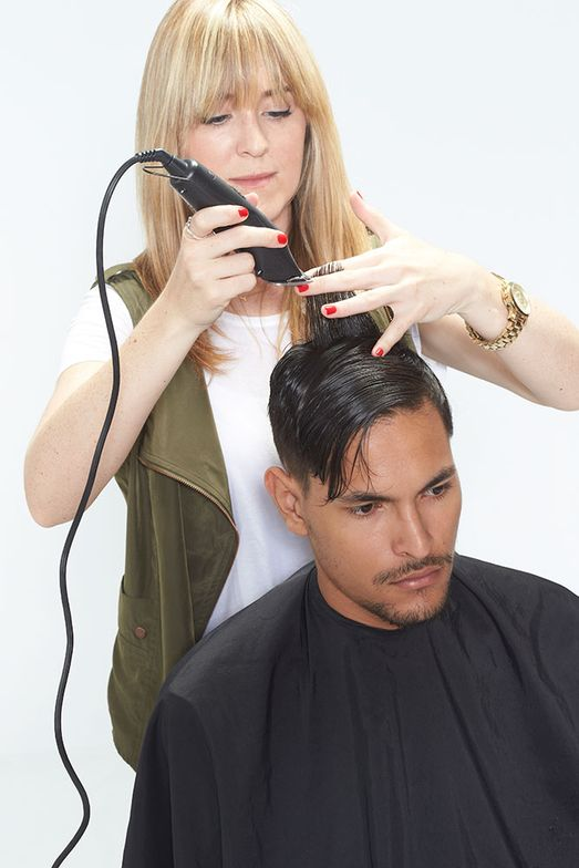 7. Project the hair straight up from the head. Using a clipper, remove the corner.