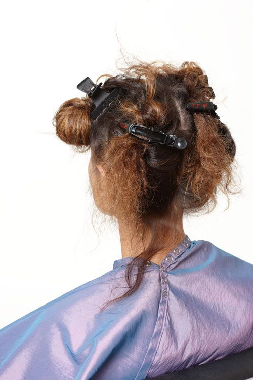 1. Shampoo hair four times and rinse thoroughly. Blow dry completely, then section hair in quadrants.