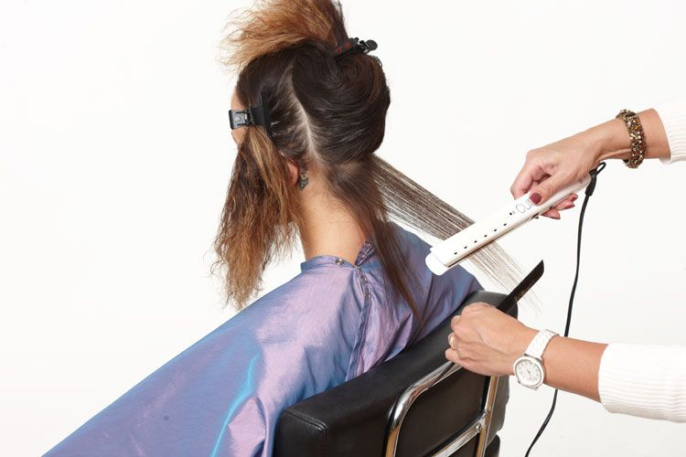 7. Now flatiron hair in ¼ inch sections. Start at the base with a higher heat 450º F cure tool. Swipe each section four times to the line of ombre color. Finish the ends with an iron set at 400º F. Again, swipe the hair four times.