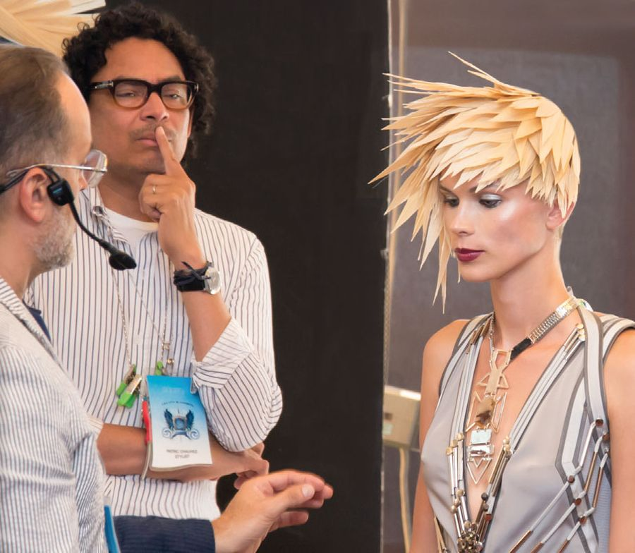 Alvarez (far left) on set with fashion stylist Patric Chauvez.