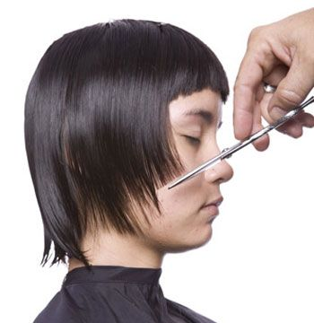 4. At the sides comb the hair down and cut at angle from high point of cheek to nape.