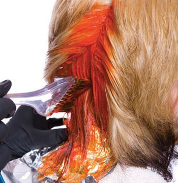 In some sections the orange will go from roots to midlengths. All short hair is colored orange. Cover and protect with foil.