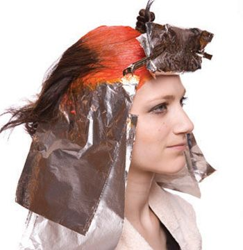"""""""Color melt"""" the customized purple to the ends in selected foils on the longer side. Process for 15 minutes, shampoo and condition."""