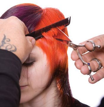 Refine the cut on dry hair. Begin on the side. Pull out with a comb and point cut to cross check.