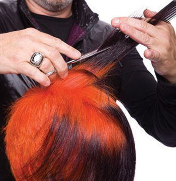 Lift up hair from the Mohawk section. Direct forward and slide cut to leave length forward.