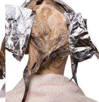 In foils, isolate several selected sections to retain base color. Continue to lift the rest of the hair.