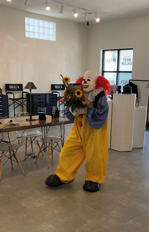 Snickers the clown surprises a stylist with a bouquet on her 4th anniversary at Bella Style Salon in Slidell, Louisiana, but another team member has a fear of clowns.
