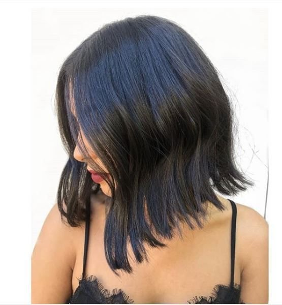 The waved out styling on this bob is a fun way to transition the hair cut from day to night seamlessly.