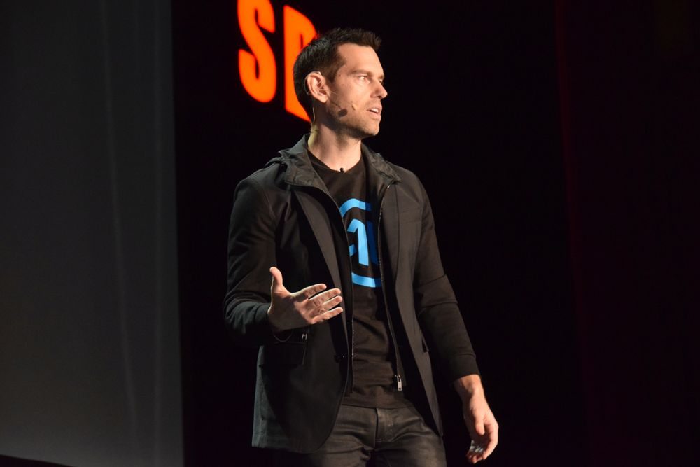 <p>Quest Nutrition&#39;s Tom Bilyeu encourages attendees to follow their passion. &quot;Mind the gap between where you are today and where you want to be,&quot; he says.</p>
