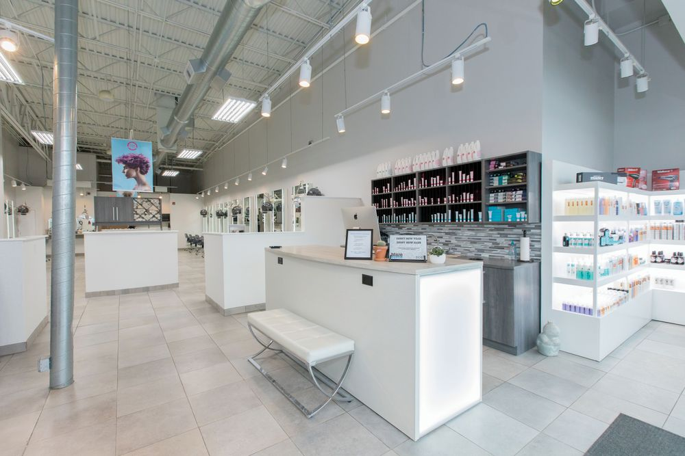 "The redesign of <a href=""https://www.blazehaircolor.com/"" target=""_blank"" rel=""noopener"">Blaze Color Salon</a> in Coralville, Iowa, used white décor to give clients a feeling of cleanliness and openness. The white color scheme provides a blank slate for the color bar to stand out and allow clients to visualize where the magic happens."