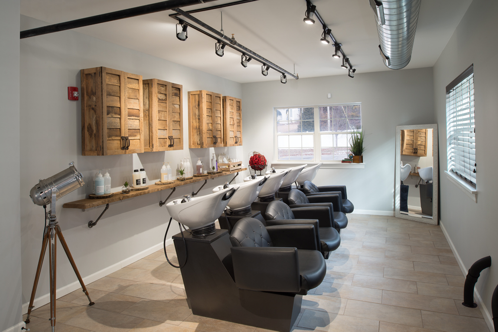 An oversize galley houses a processing bar and backwash areas. One of the backwash units was designed so the chair can be removed, to accommodate clients with wheelchairs.