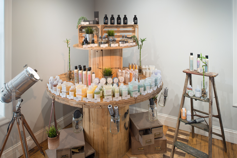 The retail area features natural hair care products.