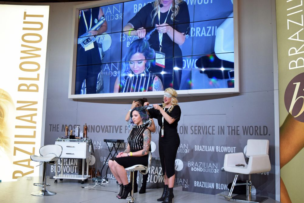 Jenny Strebe (@theconfessionsofahairstylist) styles blindfolded on the Brazilian Blowout Stage.