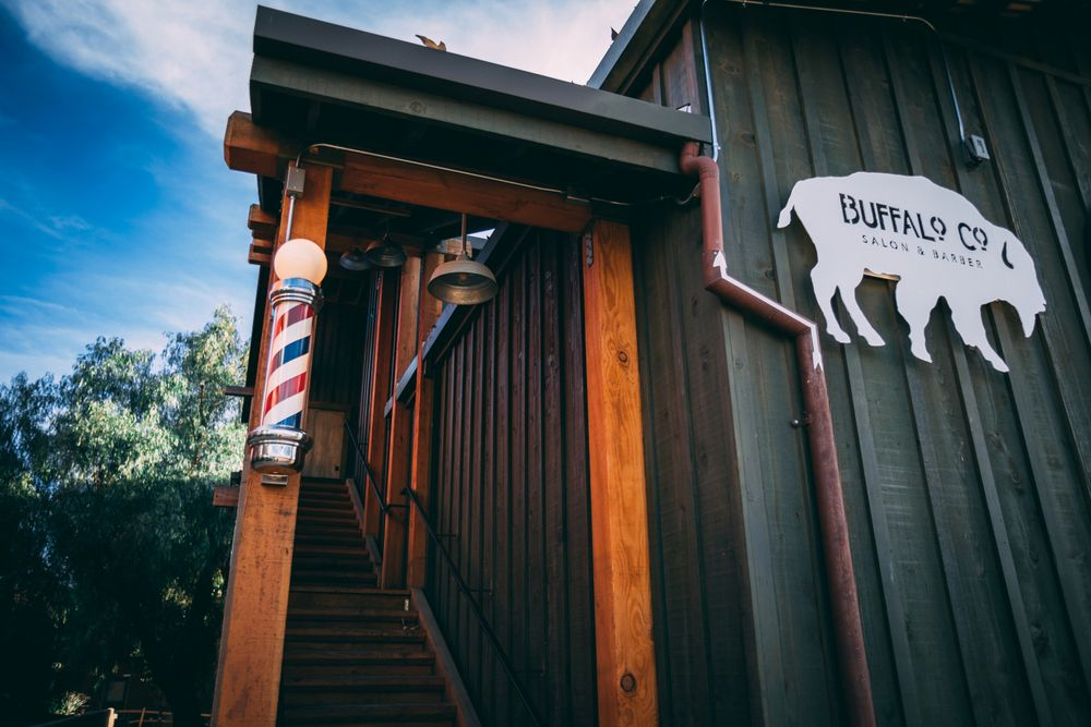 The spinning barber pole and the Buffalo signage invites clients to climb the stairs to Buffalo Co. Salon and Barber in Temecula, Califonria.