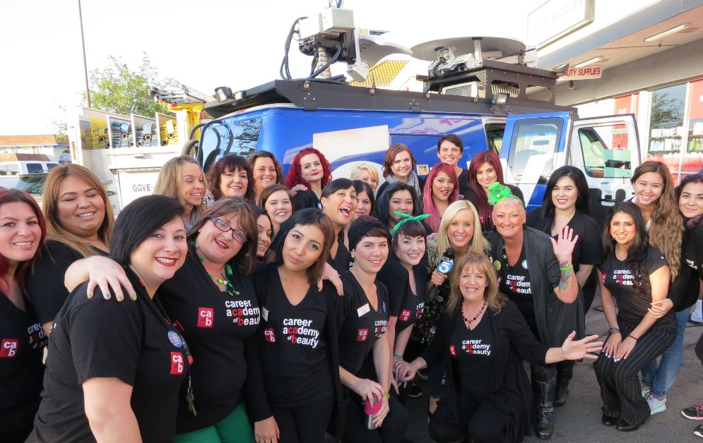 Posing with the local TV news van, students from the Career Academy of Beauty at last year's St. Baldrick's event which raised more than $21,000.