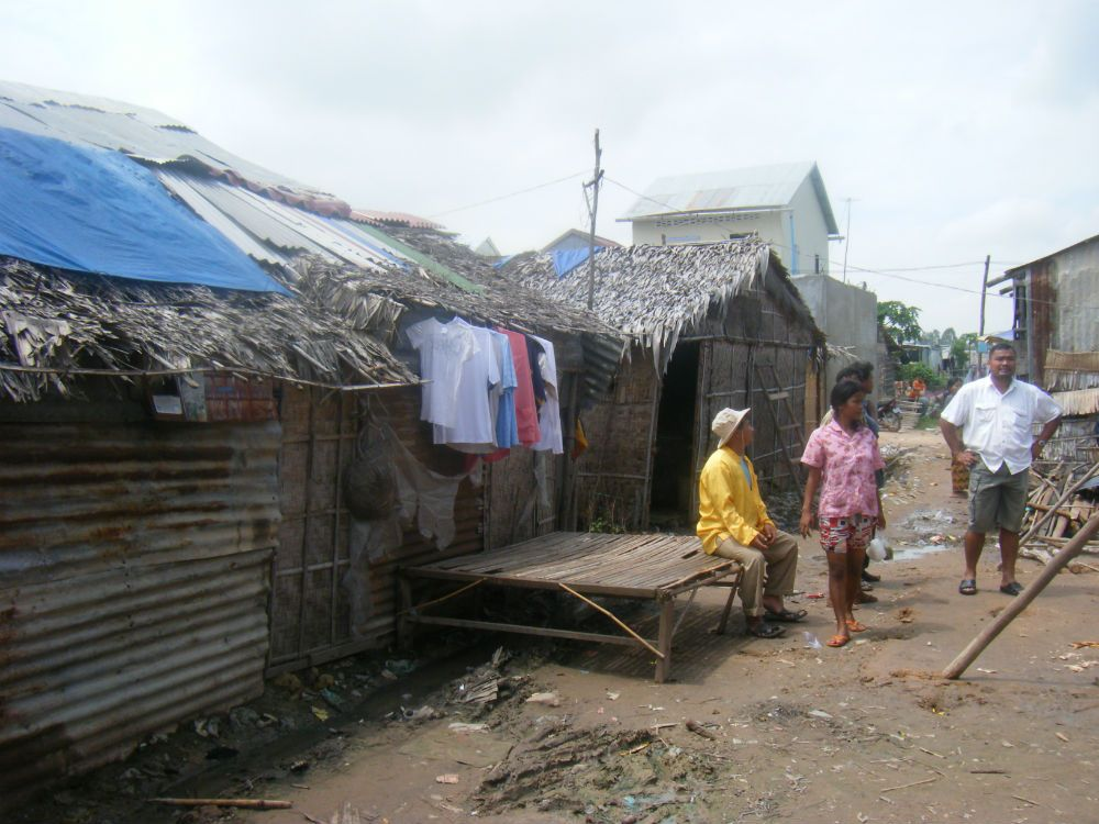 Families in a displacement camp. City homes are taken by the government from these families and they are forced to live in these dilapidated huts.