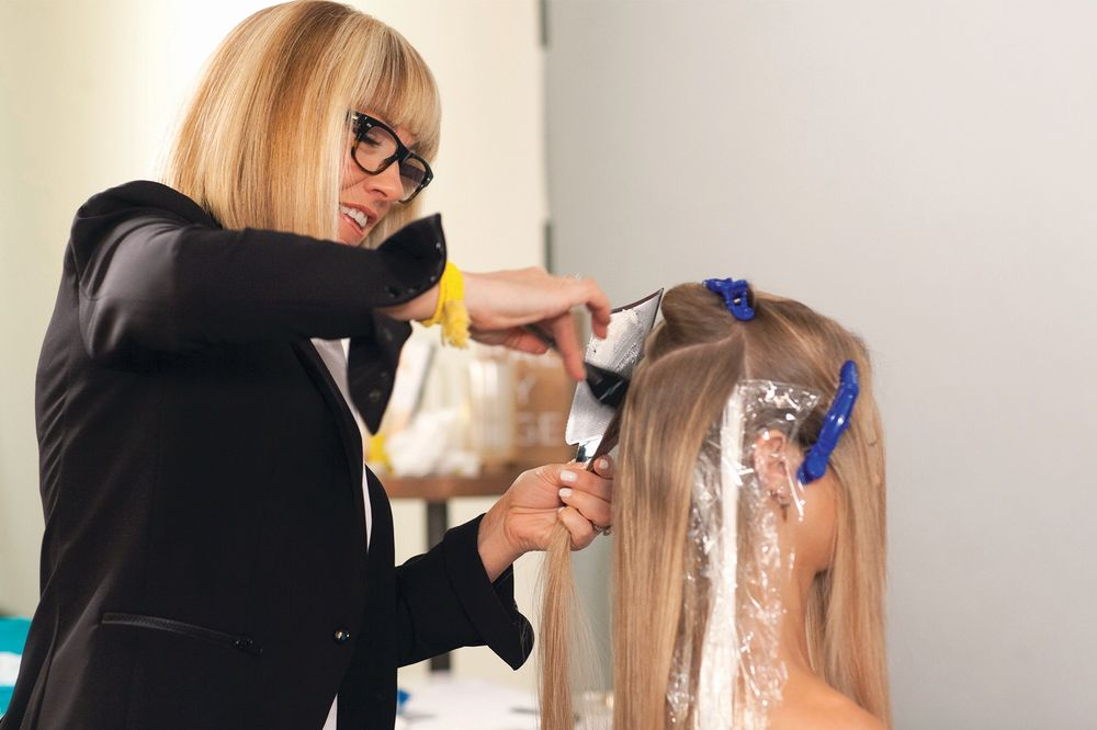 Candy Shaw, practicing the art of balayage, which ignited sales at Jamison Shaw Hairdressers in Atlanta, GA, and launched her Sunlights Balayage product line.