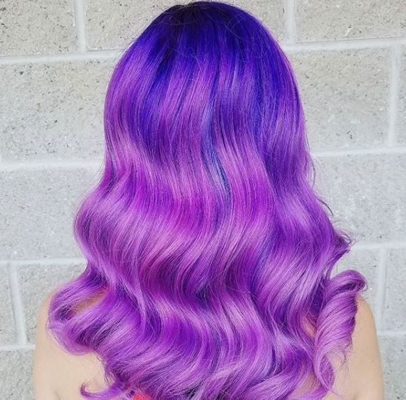 These purple waves by @juelsbeauty were created using colors from Joico's Color Intensity line.