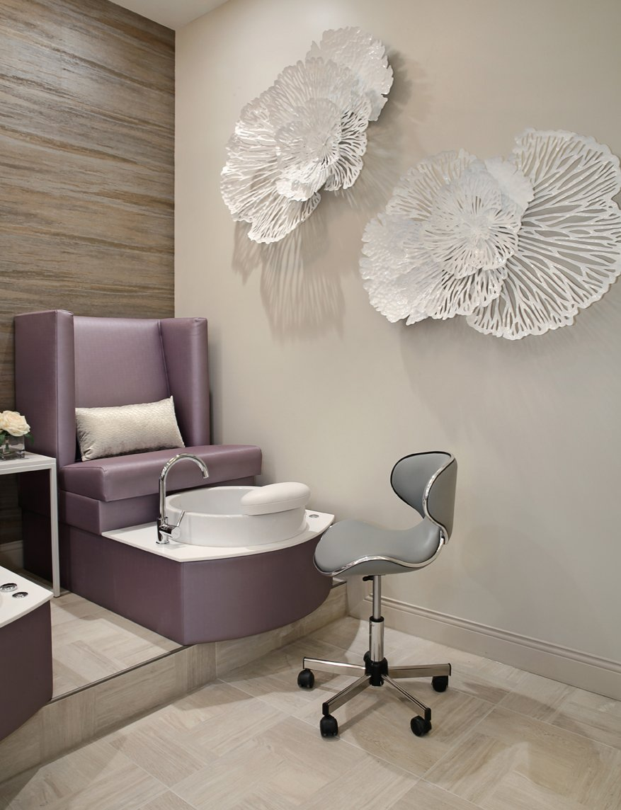 Pedicure thrones were constructed on a platform to help nail technicians work more comfortably and efficiently.
