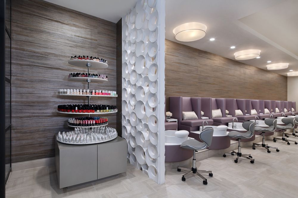 The reversed bubble wood panel helps separate the retail area from the nail area, while still allowing clients a view of the entire salon.