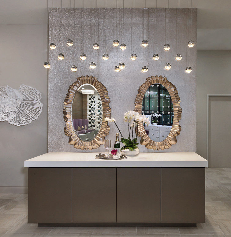 Beautiful gilted mirrors add a touch of opulence to the space.