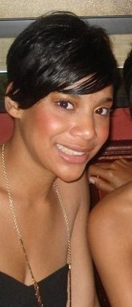 May 2009- Short side fringe cut with additional extension pieces for volume at the crown. Relaxed hair.