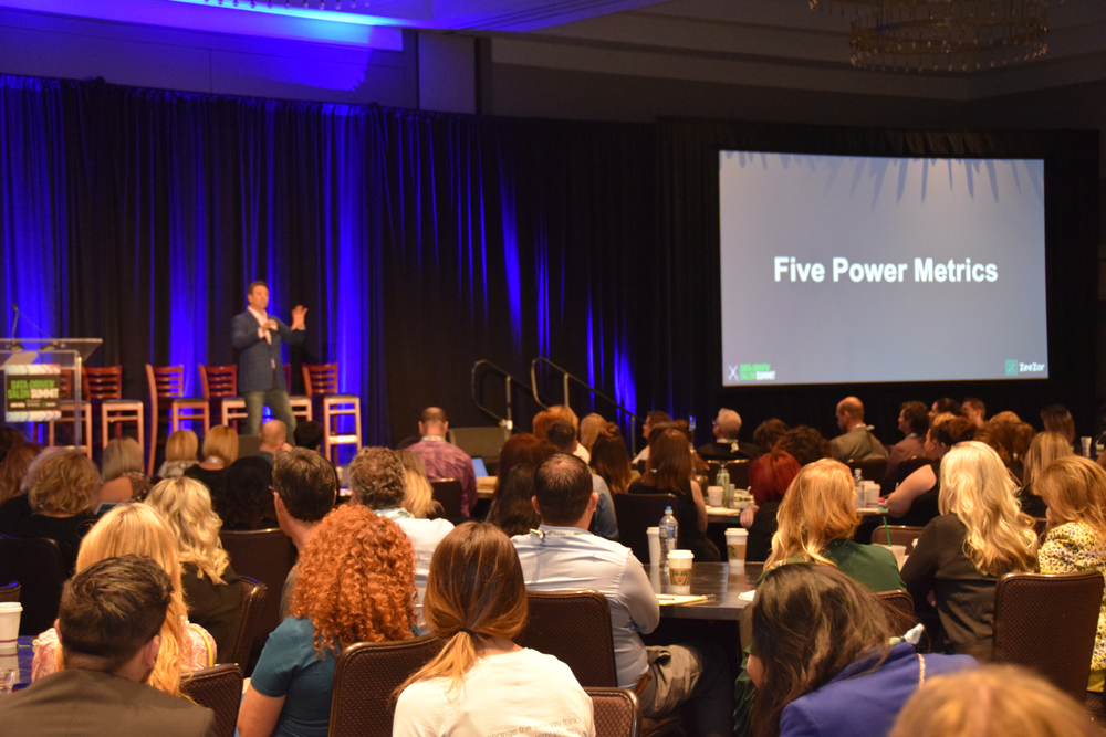 Chris Nedza introduces the five power metrics that this year's conference focused on: SGP, Productivity, Average Client Ticket, Client Count and Client Retention.