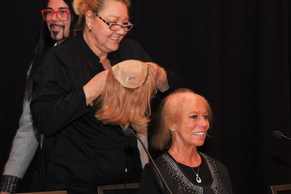 In a session on extensions and wigs with Brent Hardgrave and Marsha Scott, a brave client who suffers from female pattern baldness demonstrates the confidence she gains from a hair system.