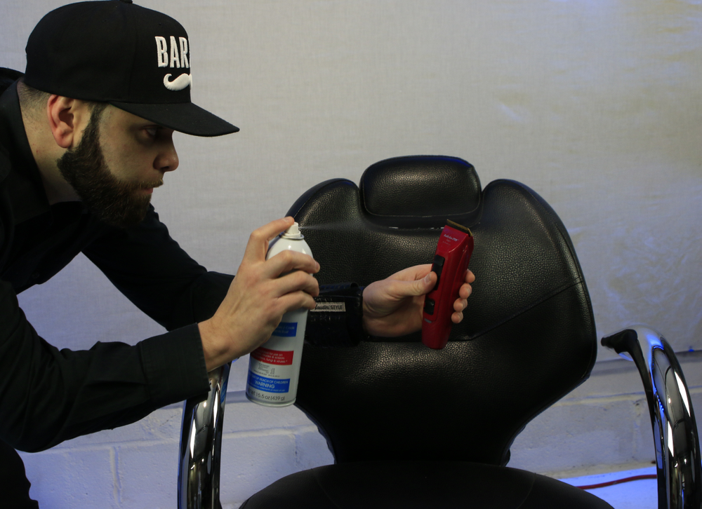 Harry Hernandez, master barber and BabylissPRO educator, maintains his clipper between each client.