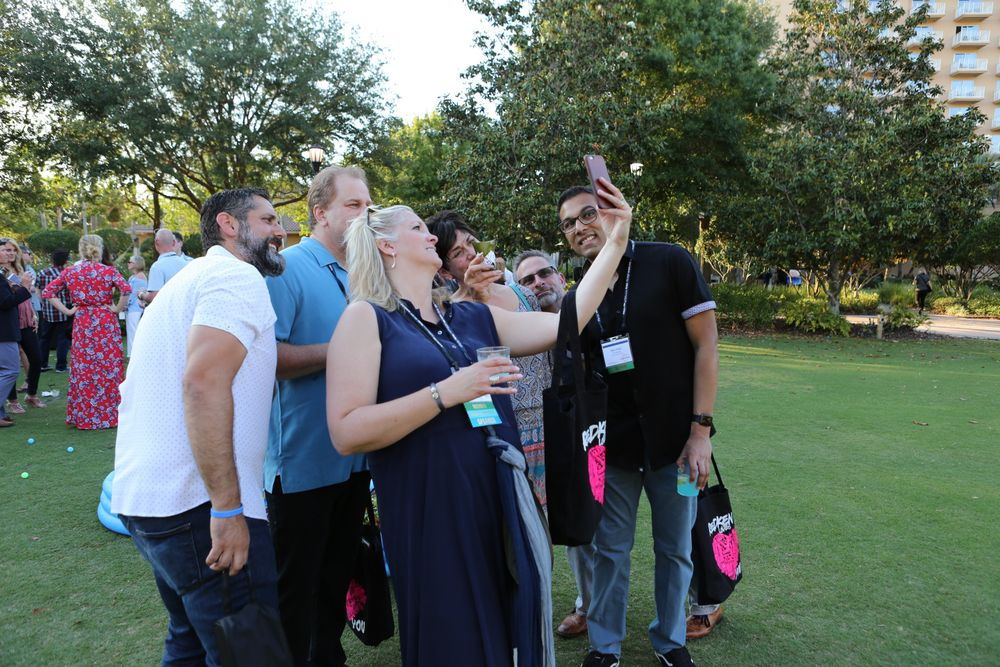 A team engages in a selfie challenge during the ISBN Happy Hour Challenge.