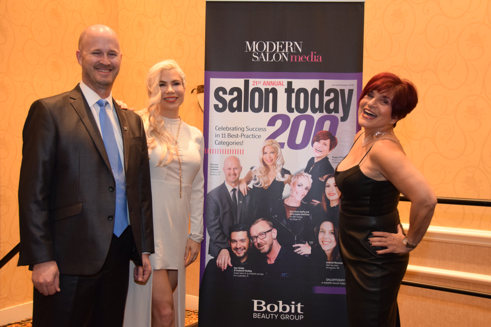 Paul and Tussanee Luebbers and Maggie DiFalco recreate their poses from the January/February cover of Salon Today.